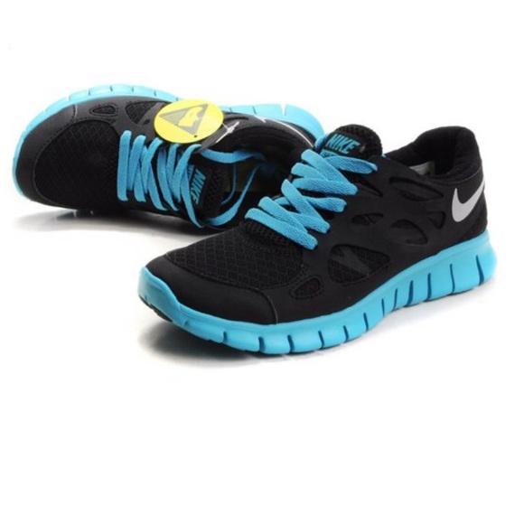 half off 186f1 a9d1f Women s Black   Light Blue Nike Free Run 2 Size 8.  M 5be33a483c98449ead9b4ddd